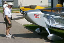 "A Fly-In attendee inspects Kerry Fores' ""Metal Illness""."